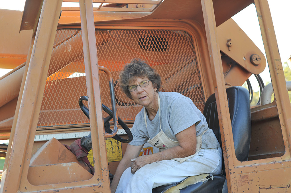 Susan Benson provided and operated the heavy equipment needed to install the quilt.