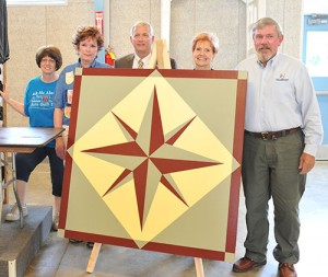 From left, Kathy McCarty, Chris Angerman and commissioners Dan Claypool, Peggy Carlo and Joe Moroski with the Mariner's Compass barn quilt.