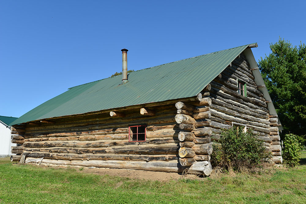 The Stevens log barn is a modern construction barn that was built from white pine logs harvested from a nearby woodlot.