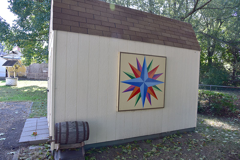 "George Gates' quilt is installed on the side of an ""urban barn."""