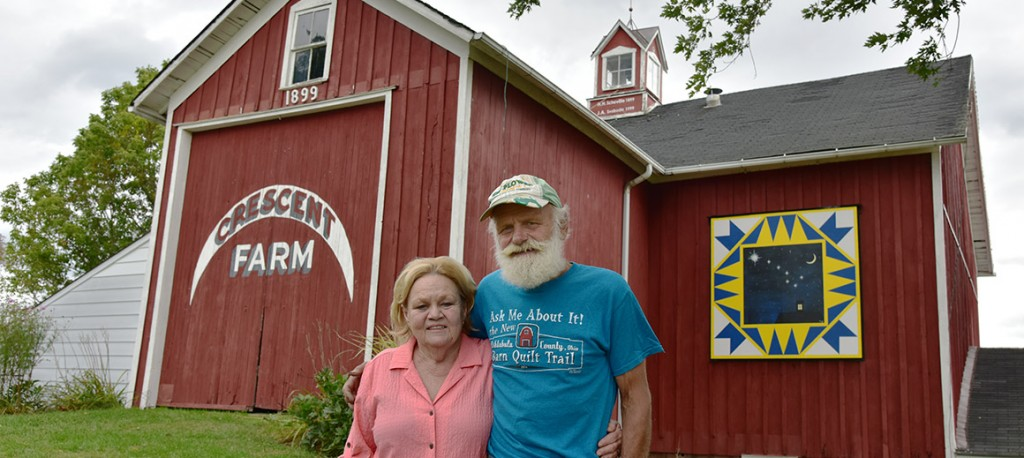 John and Mary Ellen Svoboda with their Follow the Drinking Gourd barn quilt.